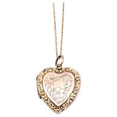 Beautiful engraved art nouveau 9 ct yellow and rose gold heart locket.