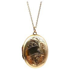 Antique engraved oval 9 ct gold locket.