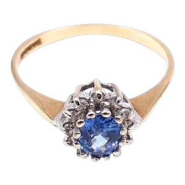 Vintage sapphire and diamond cluster ring in 9 ct gold.