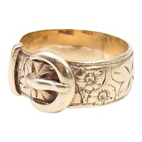 Vintage engraved 9kt gold buckle ring, a heavy engraved buckle ring with embossed floral and star motifs.