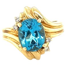 14K Yellow Gold Oval cut Blue Topaz and Diamond Ring