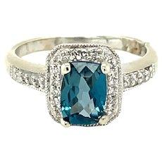10K White Gold Radiant cut Blue Topaz and Diamond Ring