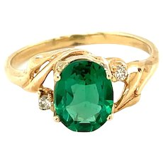 14K Yellow Gold Oval cut Emerald and Diamond Ring