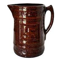 Antique Circa 1910 McCoy Stoneware Pottery Swastika Pitcher