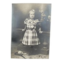 Lovely big  antique photo of a girl in an beautiful dress with toy