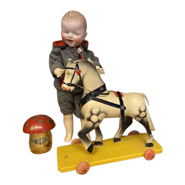 Old wooden toy horse on wheels