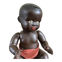 Mystery doll, black complexion composition baby doll