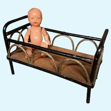 Nice Wicker doll house bed with a baby