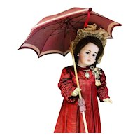 A wonderful antique French folding burgundy red parasol , umbrella