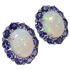 Set in 18 Karat Gold Ethiopian opal and Tanzanite studs with diamonds