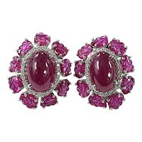 Set in 18 karat Gold natural Ruby studs with diamonds