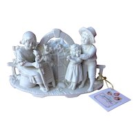 Unusual German white bisque trinket receptacle representing children playing with puppets