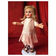 Cute French SFBJ doll #301 in size 0 from the 1920's