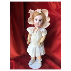 Sweet little Bébé Jumeau by SFBJ during the 1920's in size 4