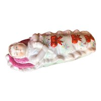 Colorful porcelain baby in bunting as trinket box