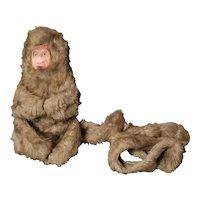Vintage 1970s cuddling monkey soft toy