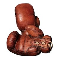 Antique leather boxing gloves, straw filled