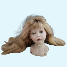 Vintage porcelain doll head, with wig