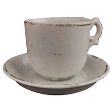 Antique childs toy tea cup and saucer