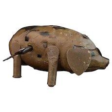 Vintage clockwork tinplate pig