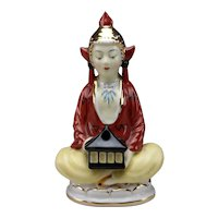 Antique Perfume Lamp of a Seated Mystical Figure