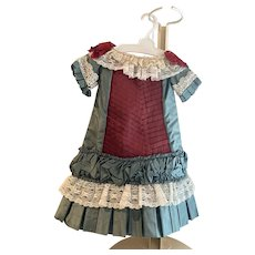 French styled dress made with teal taffeta