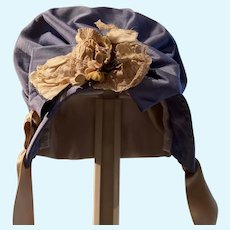 Periwinkle colored silk hat/bonnet with vintage decorations
