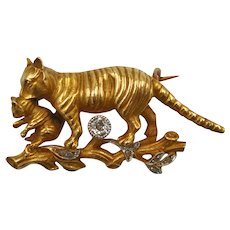 An art nouveau 18K gold and diamond cat and kitten brooch with hallmark