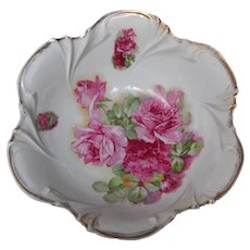 Vintage ornate serving bowl with gilded trim and pink roses