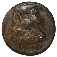 Bronze relief plaque of Terrier dog