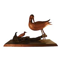 Wood carved folk art birds on wood base with driftwood