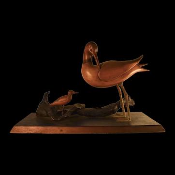 Wood carved folk art birds on wood base with driftwood