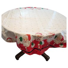Vintage Plastic Round Christmas Tablecloth Featuring Santa Claus 1950-60s Vintage condition