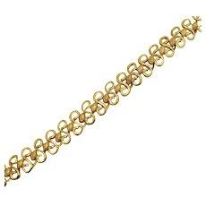 Pretty Signed Monet Vintage Yellow Gold Plated Open Swirl Metal Bracelet