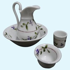 French porcelain toilette set circa 1880-1890 : a jug, a large bowl, a pot and a small bowl - violet painted pattern