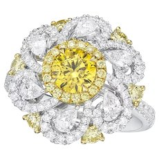 18K Gold and Diamond Ring with GIA reported 0.64CT Fancy Vivid Yellow Diamond