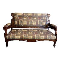 Heavily carved Arts & Crafts Settee and Armchair