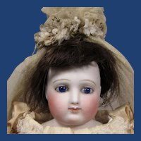 """17"""" French Bisque Poupee in Ivory Satin Gown."""
