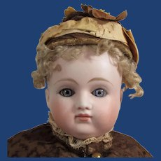 """15"""" German bisque closed mouth lady doll by Kestner."""