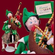 Vintage Klumpe Scottish Bagpipe Player