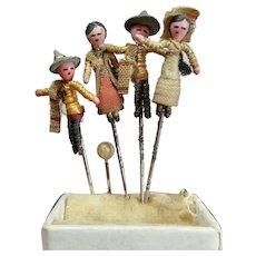 Four Tiny Miniature Dolls on pins