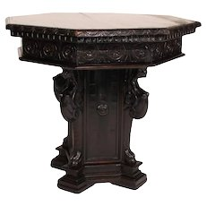 An Italian Renaissance style carved walnut octagonal top pedestal table. C. 19th century.