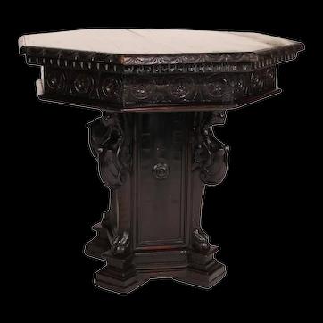 An Italian Renaissance style carved walnut octagonal top pedestal table. C. 19th century.