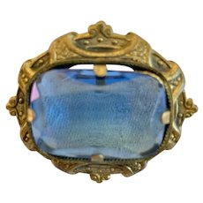 Antique Pin With Large Blue Stone In Decorative Setting.