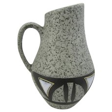 German pottery vase featuring a geometric design in matte brown and gloss white glazes over a grey light lava finish.