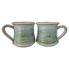 Studio pottery mugs. A pair of vintage white mugs with green accents by Knight's pottery of Tintagel Cornwall