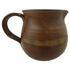 Studio pottery pitcher. Hand thrown jug in rich brown glaze. marked with 'DF' but unidentified