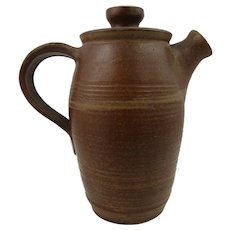Studio pottery teapot or coffeepot. Hand thrown teapot in rich brown glaze, marked 'DF' but unidentified