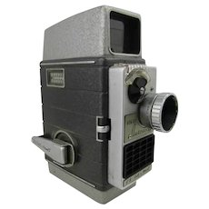 Vintage 8 mm cine camera. Bell and Howell Autoset 624 EE camera with accessories including telephoto lens