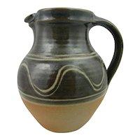 Winchcombe studio pottery pitcher or jug. Olive green wood-fired jug